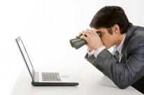 Man with binoculars and laptop
