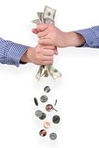 Hands wringing money