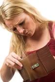 Woman looking into empty wallet