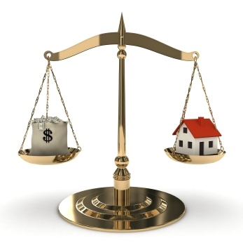 House and cash on scale
